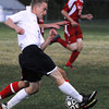 Peabody:<br /> Peabody's Ryan Wolff moves the ball with Salem's Craig Denehy, in back, fighting for possession during the Salem at Peabody boys soccer game.<br /> Photo by Ken Yuszkus, The Salem News, Monday, September 23, 2013.