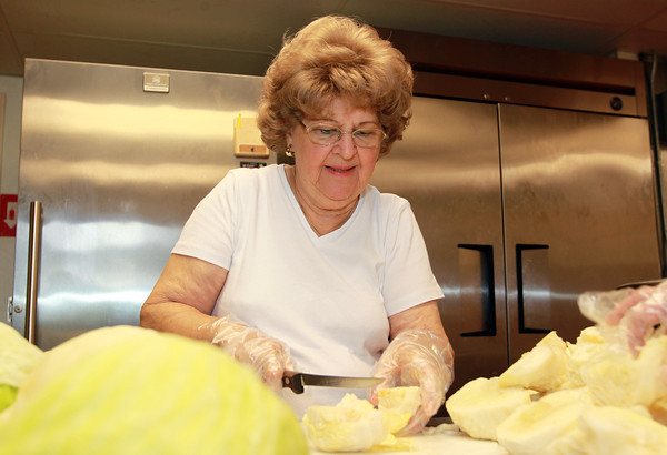 Peabody: Lola Busta prepares some cabbage to make golabki (stuffed cabbage) and kapusta (fried cabbage) for Sunday's Peabody International Festival at St. Michael's Church on Endicott St. in Peabody on Tuesday afternoon. David Le/Salem News