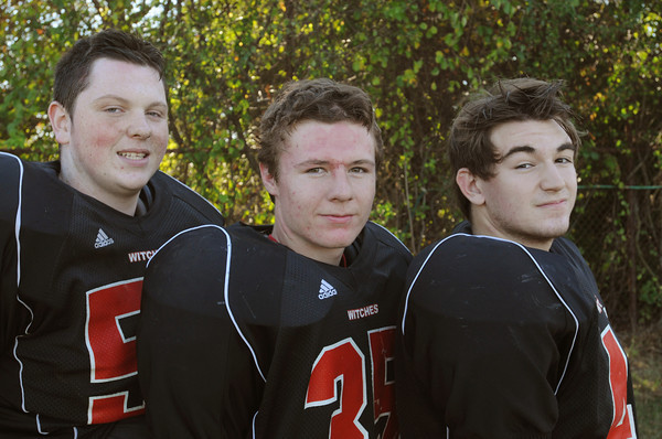 Salem:<br /> From left, Riley Grondin, Victor Claudio, and Glen Gard are Salem High School football players.<br /> Photo by Ken Yuszkus, The Salem News, Tuesday, September 24, 2013.