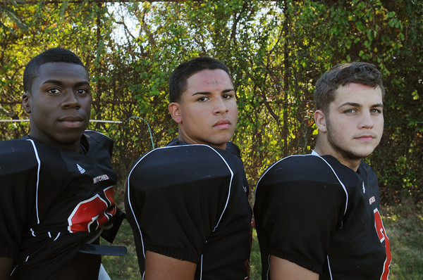 Salem:<br /> From left, Aaron Palmer, Genrri Rosario, and Christian Costa are Salem High School football players.<br /> Photo by Ken Yuszkus, The Salem News, Tuesday, September 24, 2013.