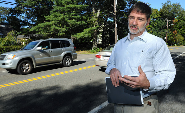 Beverly:<br /> Dan DeAngelis is one of the residents who live on Brimbal Avenue who are opposed to a new shopping center on the road, saying it will increase traffic on an already busy road.<br /> Photo by Ken Yuszkus, The Salem News, Wednesday, September 18, 2013.