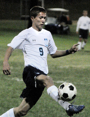 Peabody:<br /> Peabody's Ben Manoogian handles the ball during the Salem at Peabody boys soccer game.<br /> Photo by Ken Yuszkus, The Salem News, Monday, September 23, 2013.