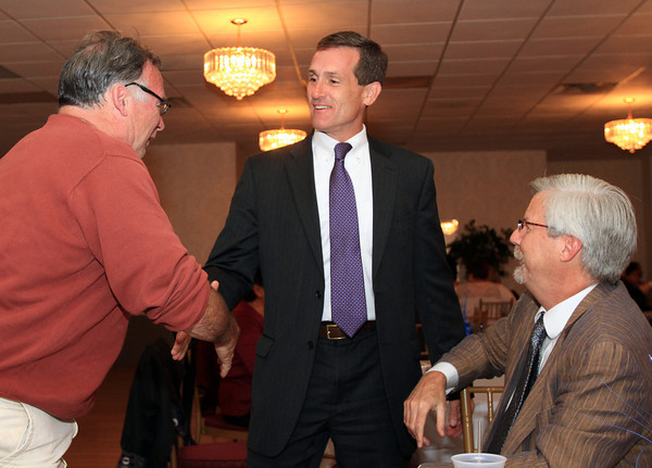 Beverly: Beverly Mayoral Candidate Mike Cahill, talks and shakes hands with Barry Checchi, left, and Paul Kusiak, right, both of Beverly, on Tuesday evening. David Le/Salem News