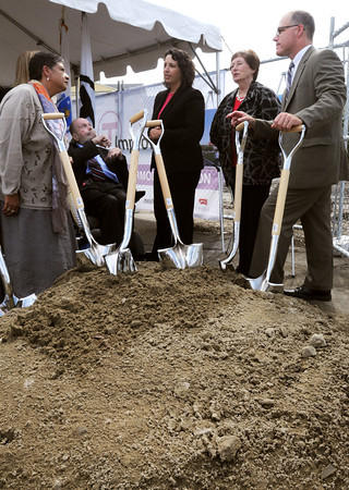 Salem:<br /> From left, General manager of the MBTA Dr. Beverly Scott, in the background, State Senator Joan Lovely, Former State Senator Fred Berry, Salem Mayor Kimberley Driscoll, Executive Director of the Salem Partnership Patricia Zaido, and State Representative John Keenan talk after digging into the dirt with their shovels at the conclusion of the ground breaking ceremony for the new MBTA Salem Commuter Rail Station on Friday.<br /> Photo by Ken Yuszkus, The Salem News, Friday, September 13, 2013.