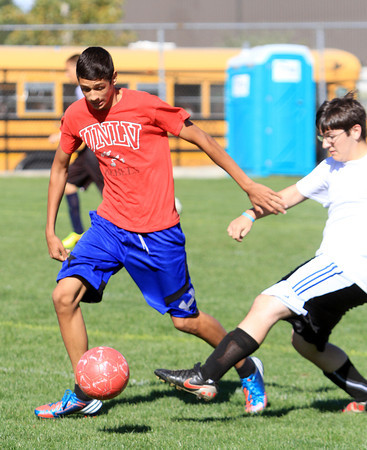 Middleton: North Shore Tech sophomore forward Sam Cueva, left, controls the ball while being pursued by senior midfielder Carter Sheehan on Tuesday afternoon. David Le/Salem News