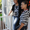Danvers:<br /> Isaura Pacheco, left, and her mother, Angela Suriel stand in the doorway of their home which is half of the duplex that Habitat for Humanity - North Shore completed in Danversport at 26 Mill Street.<br /> Photo by Ken Yuszkus, The Salem News, Wednesday, September 18, 2013.