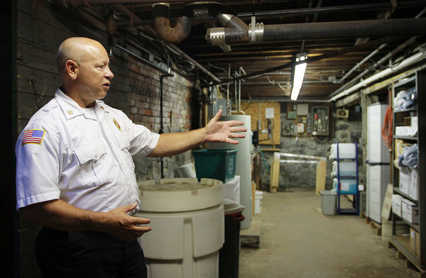 Ipswich: Ipswich Fire Chief Rick Smith talks about the small amount of storage space in the basement of the Ipswich Fire House on Wednesday afternoon. David Le/Salem News