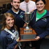 Beverly:<br /> Endicott College students from left, Madison McKinley, Taylor English, Tell White, and Julie Manning were presented the North Shore Cup at The Salem News office Monday afternoon.<br /> Photo by Ken Yuszkus, The Salem News, Monday, September 23, 2013.