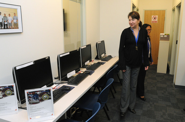 Danvers:<br /> Cristy Sugarman of North Shore Community College administration looks over the row of computers in the new veterans center at North Shore Community College after the dedication ceremony.<br /> Photo by Ken Yuszkus, The Salem News, Thursday, September 26, 2013.