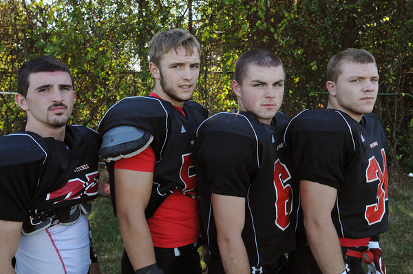 Salem:<br /> From left, Austin Connolly, Ian Carter, Josh McRae, and Patrick Charlton are Salem High School football captains.<br /> Photo by Ken Yuszkus, The Salem News, Tuesday, September 24, 2013.
