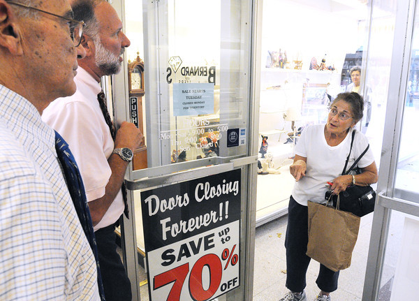 Salem:<br /> Madeleine Belisle of Salem, right, finds it hard to believe that Bernard's Jewelers is closing as she speaks with owners Ray Tetrault, left, and Tom Tetrault at the front door of the store.<br /> Photo by Ken Yuszkus, The Salem News, Monday, September 16, 2013.