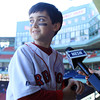 Boston: Gloucester native Jacoby Catanzaro glances out toward the Green Monster while being interviewed by NESN reporter Jenny Dell, about spending the day at Fenway Park and meeting his favorite player Jacoby Ellsbury. David Le/Salem News
