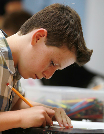 Marblehead: Marblehead Community Charter Public School fifth grader Thomas Deck concentrates on his drawing in art class on Monday afternoon. David Le/Salem News