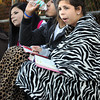 Peabody:<br /> Kristen Couto, Andres Sanchez, and Briana Couto, all of Peabody, stay warm under blankets during the Salem vs. Peabody boys JV soccer game Monday evening in Peabody.<br /> Photo by Ken Yuszkus, The Salem News, Monday, September 23, 2013.