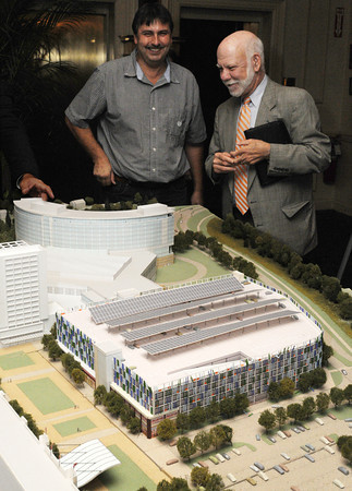 Salem:<br /> Wayne Ferreira, left, of New England Solid Waste and Gary Barrett of North Shore Alliance for Economic Development, look at the model of Caesars Resort at Suffolk Downs at the Caesars Resort at Suffolk Downs North Shore Vendor Forum held at the Hawthorne Hotel on Wednesday afternoon.<br /> Photo by Ken Yuszkus, The Salem News, Wednesday, September 11, 2013.