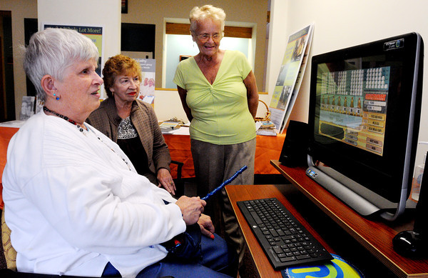 Beverly:<br /> From left, Jean Saerland, Betty Murphy, and Helen Farnsworth work on the computer to familiarize themselves with the computer, learn to communicate, discover new community resources, play games, and solve some of their daily living or health concerns on the computer with the help of advisors. The program is called The Kiosk For Living Well which is held every Tuesday at the Senior Community Center in Beverly.<br /> Photo by Ken Yuszkus, The Salem News, Tuesday, September 10, 2013.
