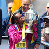 Kenyan Rita Jeptoo, who repeated as the Boston Marathon winner kisses the trophy as Governor Deval Patrick smiles on. DAVID LE/Staff photo 4/21/14