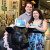 David and Angela Luongo, owners of Little Shop of Treasures, located in the Liberty Tree Mall in Danvers, have purchased one of the original Hilltop Steakhouse Cows and is now on display in their store. DAVID LE/Staff photo 4/11/14