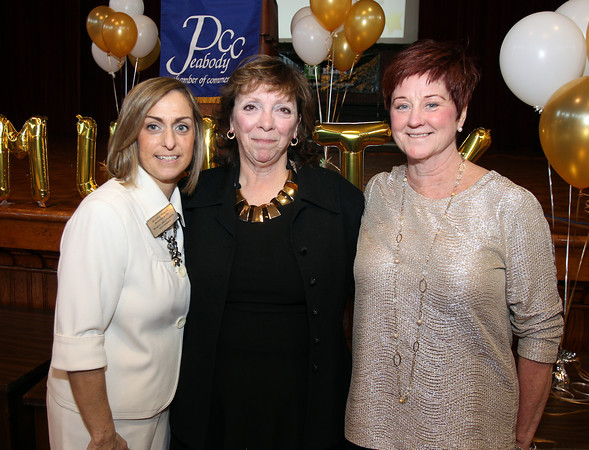 From left: Deanne Healey, President and CEO of the Peabody Area Chamber of Commerce, 2014 Desire King Award recipient Karen Batchelder, and Mary Bellavance, from the City of Peabody and Board of Directors. The 22nd annual Ferrin Community Service Awards were given out on Wednesday evening in the Wiggin Auditorium inside Peabody City Hall. DAVID LE/Staff photo 4/2/14
