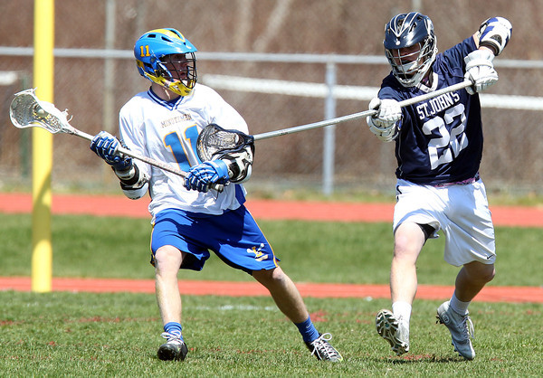 St. John's Prep defender K______ Sanford (22) stick checks Lexington attack Riley Muir (11) during the fourth quarter of play on Thursday afternoon. DAVID LE/Staff photo. 4/24/14