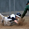 KEN YUSZKUS/Staff photo: Danvers' Raffy Tylus is picked off at 1st after just previously getting back to 1st safe on a run down between 1st and 2nd during the Lynn Classical at Danvers baseball game  in home opener at Twi Field at Plains Park.