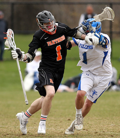 Beverly junior midfielder Ian Butler (1) tries to drive past Danvers midfielder Matt Flynn (1) during the third quarter of play on Monday afternoon. DAVID LE/Staff photo. 4/28/14