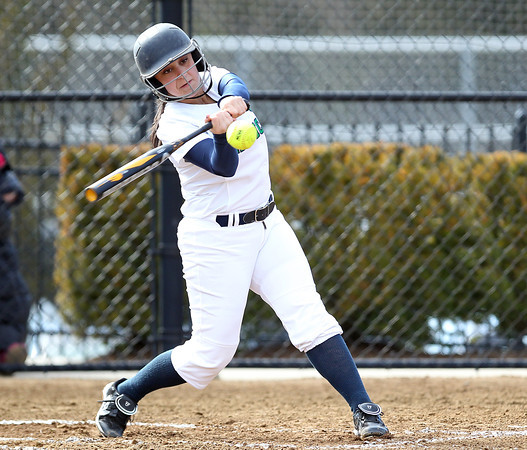 Endicott College sophomore and Danvers native Sam DiBella (19) makes contact against Wentworth and manages to reach first on a fielder's choice during the Gulls' 8-run first inning. The Gulls swept the Leopards, (15-1, 12-1) on Wednesday afternoon. DAVID LE/Staff photo 4/2/14