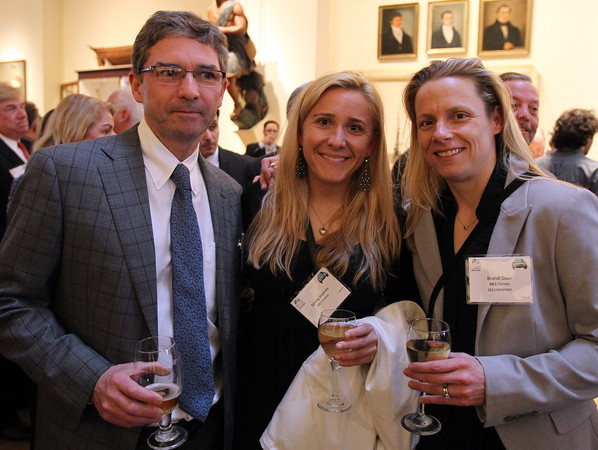 From left: Tim Clarke, of Waters & Brown, and Ashley Steeves and Brandi Dion of B&S Fitness, at the Annual Salem Chamber of Commerce Dinner held at the Peabody Essex Museum on Wednesday evening. DAVID LE/Staff photo. 4/23/14