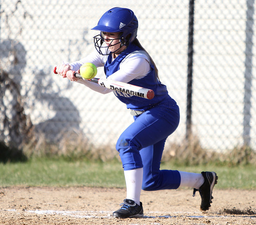Danvers junior Meagan Llewellyn (10) makes contact off Marblehead starting pitcher Michaela Leblanc during the second inning of play. Danvers defeated Marblehead 6-1 on Wednesday afternoon behind Marblehead Veterans Middle School. DAVID LE/Staff photo 4/16/14