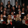 Members of the Gordon College Women's Choir under the direction of Faith Leuthe, provide a few musical numbers during Yom HaShoah 2014 held in the auditorium at Peabody Veterans Memorial High School on Monday evening. DAVID LE/Staff Photo. 4/28/14