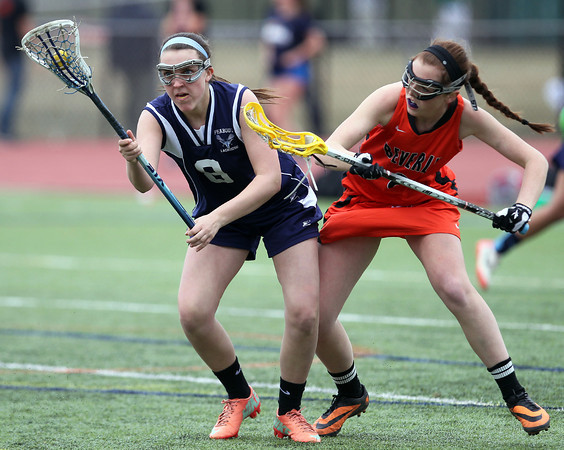 Peabody midfielder Sydney Cooke (8) keeps control of the ball while being pressured by Beverly defender Maddie Curran (8) during the first half of play. DAVID LE/Staff photo. 4/11/14