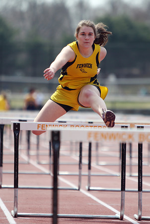 Bishop Fenwick senior Becky Woodcock clears a hurdle during the 110 hurdles in a dual meet against St. Mary's (Lynn) and Cathedral on Tuesday morning at Bishop Fenwick High School in Peabody. DAVID LE/Staff photo. 4/22/14