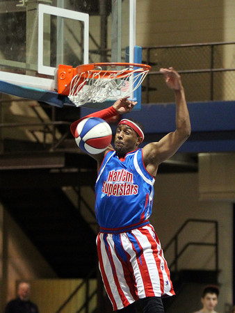 Harlem Superstars player Wi-Fly throws down a slam dunk in a game against the Peabody Firefighters at Peabody High School on Saturday afternoon. DAVID LE/Staff photo. 4/19/14