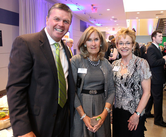 """Tim and Janis Clifford, left, and Cynthia McGurren, at a gala held in the atrium of the Gassett Fitness Center on Saturday evening. The university announced the public phase of a $25 million campaign, the largest fundraising initiative ever taken by the university, and announced that they've already raised $15 million towards the goal in a private phase of the campaign, which they called """"10,000 reasons."""" DAVID LE/Staff photo. 4/12/14"""