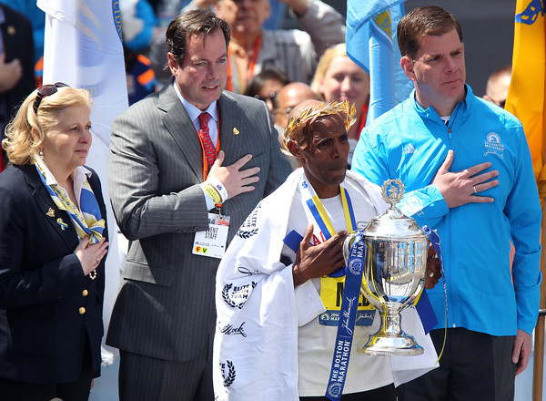 Meb Keflezighi, the 118th Boston Marathon Men's Elite champion holds his hand over his heart during the playing of the Star Spangled Banner. DAVID LE/Staff photo 4/21/14