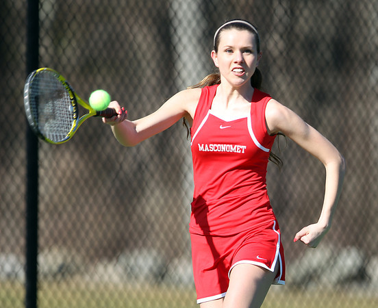 Masco senior captain Evelyn Harbert concentrates while returning a volley against Pingree in a non-league match on Tuesday afternoon. DAVID LE/Staff photo 4/1/14