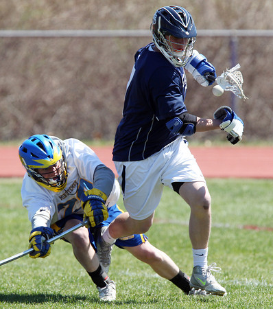 St. John's Prep attack _____ Sanford (7) loses control of the ball after being checked by Lexington's Ben Jenness (28) during the fourth quarter of play. DAVID LE/Staff photo. 4/24/14