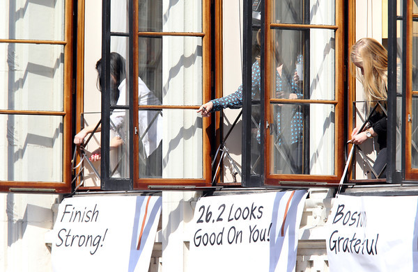 Many people along Boylston Street hung signs of thanks and encouragement out their windows for thousands of runners and spectators to see as they approached the finish line. DAVID LE/Staff photo 4/21/14