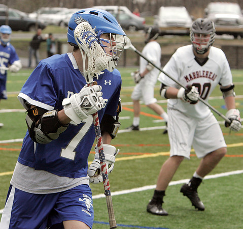 KEN YUSZKUS/Staff photo.  Danvers' Troy Fleming moves the ball during the Danvers at Marblehead boys lacrosse game. 4/23/14