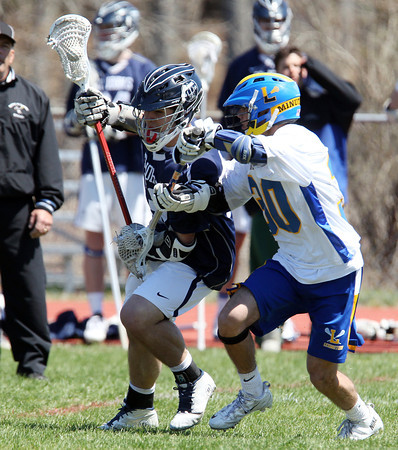 St. John's Prep _____ Fulgione (33) is defended by Lexington's Andrew Greer (30) on Thursday afternoon. DAVID LE/Staff photo. 4/24/14