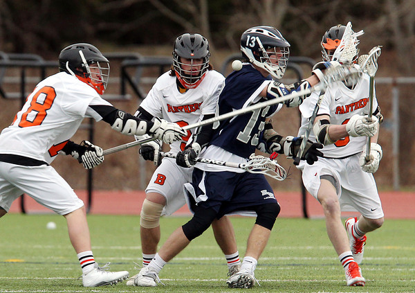 Hamilton-Wenham senior captain Matt Curran (13) loses control of the ball while being hassled by Beverly defenders Harrison Gallagher (18), Jordan Rawding (34) and Ty Martz (3) on Friday afternoon. DAVID LE/Staff photo 4/4/14