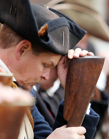 "Steve Orne, a member of Marblehead's Glover's Regiment bows his head against his musket while ""Taps"" is played during a ceremony at Armory Park as part of the 377th Anniversary of the First Muster on Salem Common. DAVID LE/Staff photo 4/5/14"