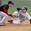 KEN YUSZKUS/Staff photo. Danvers' Jordan DiDonato is safe on 2nd base where Marblehead's Tim Kalinowski tries for a tag during the Marblehead at Danvers baseball game.