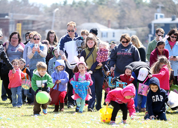 Excited Easter Egg hunters stream out onto the field at Beverly High School during Netcast's 4th annual Easter Egg Hunt on Saturday morning. DAVID LE/Staff photo. 4/19/14