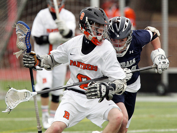 Beverly junior attack Nick Albano (8) shields the ball while being hassled by Hamilton-Wenham sophomore defenseman Jimmy Littlefield (44) on Friday afternoon. DAVID LE/Staff photo 4/4/14
