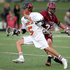 Beverly freshman midfielder Sam Abate flies past Gloucester defense Jacob Taormina (33) during the third quarter of play on Thursday afternoon. DAVID LE/Staff photo. 5/1/14