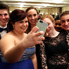 Salem High School sophomore Ian Byrne, and juniors Angelica Wronkowski, Melissa Trainor, Victoria Stout, and Colby Leclerc pose for a selfie at Salem High School's junior prom held at the Peabody Marriott Hotel on Friday evening. DAVID LE/Staff photo 4/4/14
