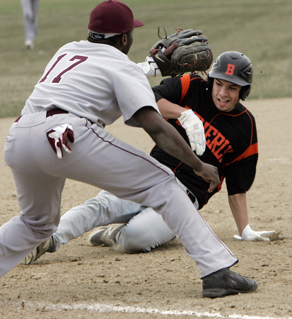 KEN YUSZKUS/Staff photo. Beverly's Jon Berchoff is safe on 3rd at the Lynn English at Beverly High School baseball game.