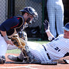 St. John's Prep junior Ted McNamara (21) slides safely across home plate as Central Catholic Catcher Jon Parsons can't corral the throw to the dish. The Eagles cruised to a 9-3 win over the Raiders at St. John's Prep in Danvers on Thursday afternoon. DAVID LE/Staff photo 4/10/14
