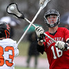 Marblehead midfielder Manning Sears (18) makes a pass around the stick of Beverly junior defense Bryan Flaherty (33) during the first quarter of play on Tuesday evening. DAVID LE/Staff photo 4/15/14